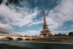 Eiffel tower near the Seine river, Paris symbol and iconic landmark in France, on a bright sunny day. Famous touristic. Places and romantic travel destinations Royalty Free Stock Images