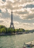 Eiffel tower near the Seine river, Paris symbol and iconic landmark in France, on a bright sunny day. Famous touristic. Places and romantic travel destinations Stock Image