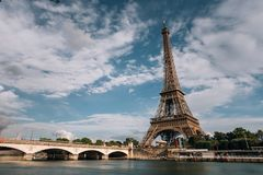 Eiffel tower near the Seine river, Paris symbol and iconic landmark in France, on a bright sunny day. Famous touristic. Places and romantic travel destinations Stock Photo