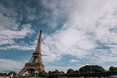 Eiffel tower near the Seine river, Paris symbol and iconic landmark in France, on a bright sunny day. Famous touristic. Places and romantic travel destinations Royalty Free Stock Photo