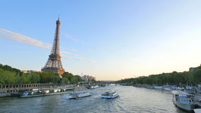 Eiffel Tower next to the River Seine at sunset. The Eiffel tower building is a wrought iron lattice tower on the Champ de Mars in Paris, France stock video footage