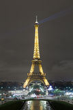 Eiffel Tower at Night. Vertical Eiffel Tower illuminated at night from Jardins du Trocadero with beams of light from the tower stock photography