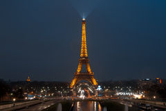 Eiffel tower at night. PARIS, FRANCE - MARCH 24: The Eiffel tower illuminated on twilight on March 24, 2012 in Paris, France royalty free stock image