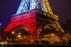 Eiffel tower at night. Colors of the french flag after Paris attacks in 2015 13th of November royalty free stock photos
