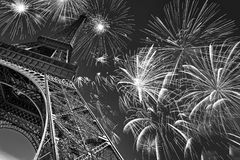 Eiffel tower at night with fireworks, french celebration and party, black and white image, Paris France Royalty Free Stock Photo
