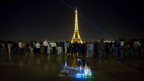Eiffel Tower by night full of tourists, view from Trocadero, Paris, France. royalty free stock photography