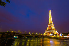 Eiffel Tower at Night and the Iena Bridge. View of the Iena bridge over the Seine river and the Eiffel Tower at Night in Paris Stock Image