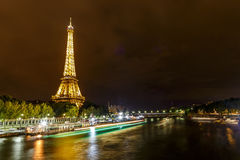 Eiffel Tower at Night and the Iena Bridge. View of the romantic Iena bridge over the Seine river and the Eiffel Tower at Night in Paris Stock Photos