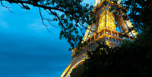Eiffel tower at night. Paris, France. Stock Photos