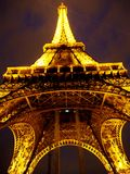 Eiffel Tower at night. In Paris, France Stock Images