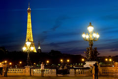 Eiffel Tower at night. PARIS, FRANCE - AUGUST 25, 2016. View on illuminated Eiffel Tower from Pont Alexandre III at night, France Royalty Free Stock Photos