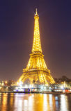 The Eiffel Tower at night, Paris, France. Stock Photos