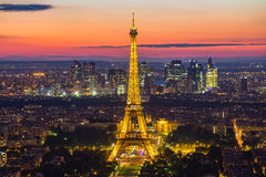 Eiffel Tower at night in Paris, France Stock Images