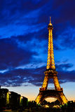 The Eiffel Tower at night in Paris, France Stock Image