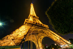 The Eiffel tower at night in Paris Stock Photography