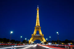 Eiffel Tower at night in Paris. Long exposure shot of car traffic light trails by the Eiffel Tower in Paris Stock Photography