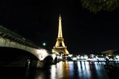 Eiffel tower at night in Paris Stock Photo