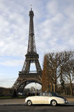 Eiffel tower and old car. Eiffel tower and cloudy sky, close up on  eiffel tower Stock Images