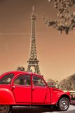 Eiffel Tower with old red car in Paris, France royalty free stock images