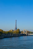Eiffel tower over Alexandre III Bridge, Paris Royalty Free Stock Photo