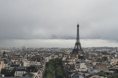 Eiffel Tower over buildings of Paris, France royalty free stock images