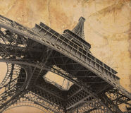 Eiffel tower over old adventure map. Background Royalty Free Stock Photos