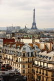 Eiffel tower over the roofs Royalty Free Stock Image