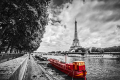 Eiffel Tower over Seine river in Paris, France. Vintage. Eiffel Tower over Seine river in Paris, France. Red tourist ship on water. Vintage, black and white Stock Photography