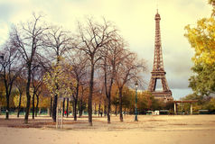 Eiffel tower paris. View of eiffel tower in paris across Champ de Mars, artistic filter applied to the picture Stock Photo