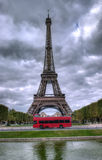 Eiffel Tower Paris. Dark scene of Eiffel tower in Paris, France and red bus Stock Images