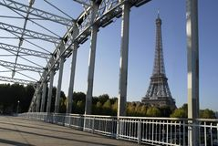 Eiffel Tower of Paris. Seen of a metal footbridge Stock Image