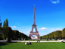 Eiffel Tower in Paris. Eiffel Tower and Champs de Mars with blue sky in Paris Stock Photos