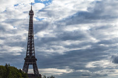 Eiffel tower in Paris against dramatic twilight sky at evening summer time. Royalty Free Stock Image