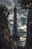 Eiffel tower in Paris against dramatic twilight sky at evening summer time. Stock Photos