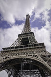Eiffel Tower Paris Architecture. A wide angle view looking up at the famous Eiffel Tower in Paris, France. This photograph shows the amazing and detailed metal stock images