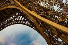 Metal arc detail eiffel tower. Eiffel tower, Paris from below, showing the amazing metal arc Royalty Free Stock Image
