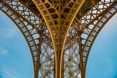 Spectacular view on the metal arcs of the Eiffel tower. Eiffel tower, Paris from below, showing the spectaculair arc perfectly centrated Royalty Free Stock Photography