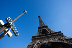 Eiffel Tower with Traffic Sign Royalty Free Stock Photography