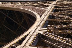 Metal structure detail at the Eiffel tower. Eiffel tower, Paris in a close-up view showing the great industrial metal structure Stock Photo