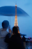 Eiffel tower in Paris with couple at dusk Royalty Free Stock Photography