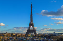 Eiffel Tower, Paris. The famous Eiffel Tower (Tour Eiffel) and Paris skyline seen from the Chaillot hill (Trocadero), with a beautiful blue sky and some clouds royalty free stock photos
