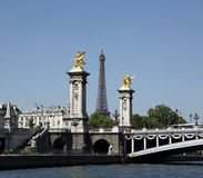 Eiffel Tower, Paris, France. The Eiffel Tower (French: La Tour Eiffel). iGustave Eiffel. The Eiffel Tower is seen between the Golden Sculptures on the Pont Royalty Free Stock Images