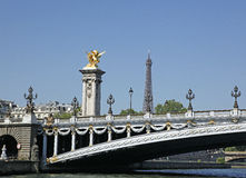 Eiffel Tower, Paris, France. The Eiffel Tower (French: La Tour Eiffel), In foreground is the Pont Alexandre III Bridge with Golden sculptures Royalty Free Stock Photography