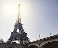 The Eiffel Tower in Paris, France. The Eiffel Tower and the sun in Paris, France royalty free stock images