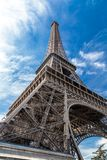 Eiffel Tower in Paris, France on a blue sky.  Royalty Free Stock Images