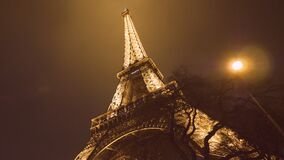 Eiffel Tower Paris France cinematic night shot. PARIS, FRANCE - JAN 2019: Cinematic motion night twilight illuminated majestic Eiffel Tower down to top view in stock video