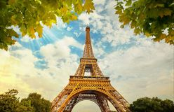 Eiffel Tower in Paris France with Golden Light Rays. Royalty Free Stock Photos