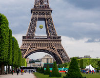 Eiffel Tower Paris. Paris, France May 26 2015: Eiffel Tower at time of French Open Tennis Tournament Roland Garros, tennis ball hanging from tower Stock Photos