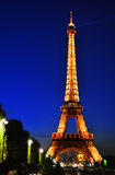 The Eiffel Tower in Paris, France in the night.  Stock Photos