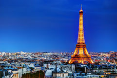 Eiffel Tower, Paris, France at night. Rooftop view on the Eiffel Tower from Arc de Triomphe. Sunny day, blue sky. Tour Eiffel Stock Photos